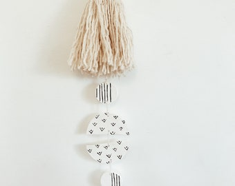 Betty- clay and tassel wall hanging