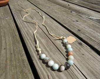 Mixed teal glass beaded necklace with soft beige leather chords