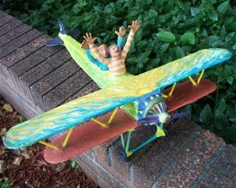 "Airplane Folk Sculpture, ""Ciero and Bella and their Flying Machine"""