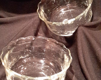 Clear glass dish with scalloped rim