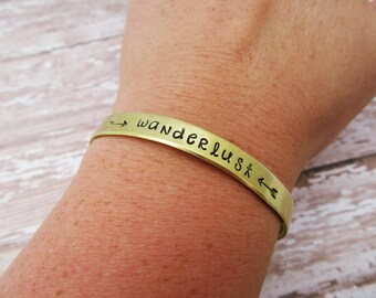 Wanderlust Bracelet - Gift For Traveler - Hand Stamped - Arrow Jewelry - Travel Quote