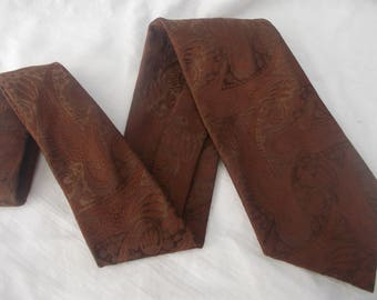 Men's 60s - 70s wide polyester tie by tie by Austico Club 300. Made in Australia.  Solid chocolate brown with an embossed design.
