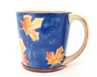 Blue puffy maple leaf themed Earthenware mug. Wheel thrown, food safe leafy mug made by Kaitlyn Brennan / Brennan Pottery