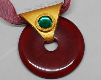 Red Donut Necklace with Gold Polymer Clay Setting and Green Glass Accent