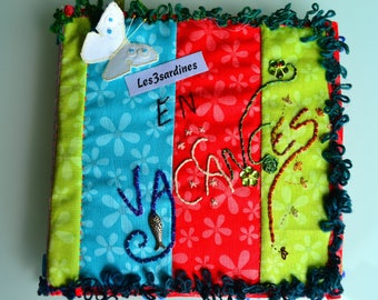Personalized embroidery and fabric photo album