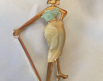 Woman with golf club brooch