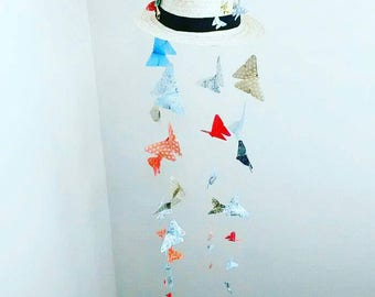 Decorative hanging in origami, origami butterflies suspended from a straw hat for home decor. Wedding, christening...