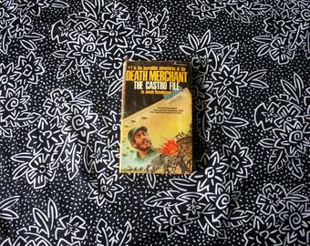 Death Merchant: The Castro File. By Joseph Rosenberger. Rare 1974 First Edition Pulp Crime Spy Communist Castro Novel.