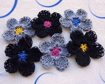 crocheted gray, black and multicolor flowers