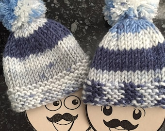 A Pair of Hand Knitted Egg Cosies - multi coloured blue