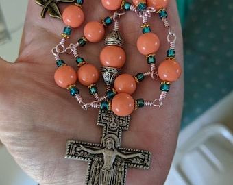The Dismas is an Irish Penal Rosary with special Crucifix, Peach beads. Double Wrapped method with Ring (explained below).