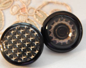 Design Under Plastic - 2 Vintage Buttons