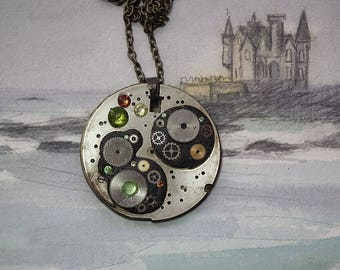 Steampunk pendant : Gustav Klimt Style, watch Mecanism & cogs, black resin and green and yellow Swarovski cristal cabs(also  3 in 1 Jewel)
