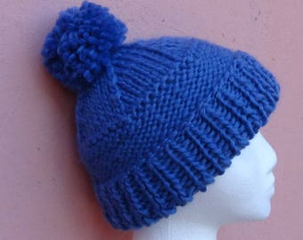 Women's knitted hat with pom poms