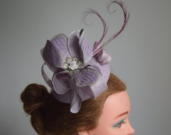 Lilac Purple half egg shaped pillbox with burnt curled feathers Wedding,  Royal Ascot, High Tea