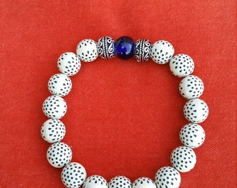 resin beads hammered with silver metal bead and dark blue glass bead