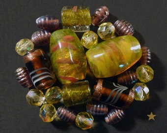Glass beads lampwork yellow, amber, gold, purple of various shapes