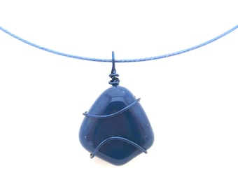Blue necklace that can be worn on a cord or at the neck on a hoop