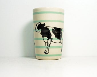 itty bitty cylinder/vase/cup pinstriped blue-green with a Holstein cow print on it, made to order.