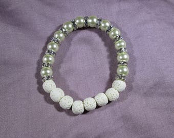 Aromatherapy essential oil diffuser bracelet with 8mm Pearl glass beads and 8mm white Lava beads.