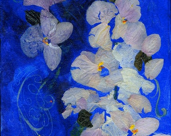 Orchid Blues, an original artwork of acrylic paint and orchid petals on canvas, in a silver toned frame.