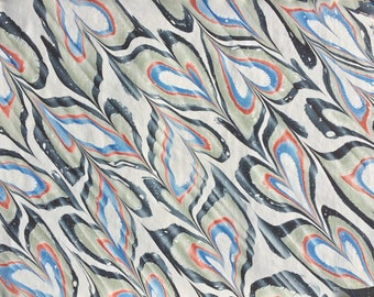Marbled paper Featuring Spanished Mars Red, Green, Black and Prussian Blue Hearts