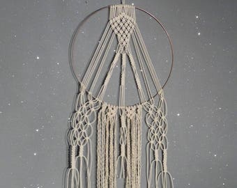 Decoration in macramed, copper circle and fine natural rope