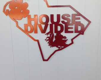 Metal art displaying house divided