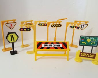 A dozen small traffic signs will tell your dolls and vehicles to Stop! Yield! Turn right! Caution -- High Power Lines! and Beware Swamp!