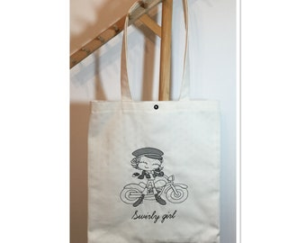 Cotton tote bag off-white embroidered of a young girl on bike