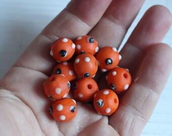 Orange lamp work beads from nepal