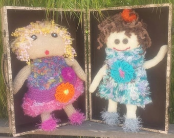 Handmade knitted dolls.