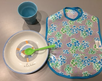 Cotton bib coated Petit Pan with blue flowers