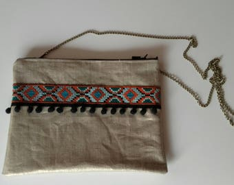 Zipped hand clutch in linen with ethnic Ribbon and tassels