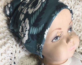 Slate Blue Floral Slouch Cap Hat. Cool organic cotton hat in sizes preemie to 6 years. Double-sided and can be folded up.