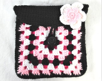 Makeup case in black, pink and white crocheted granny square