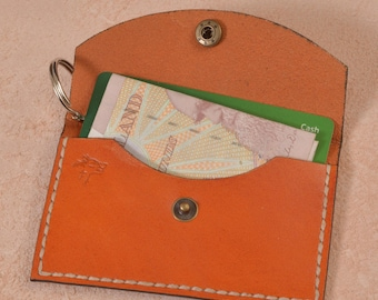 Tan coloured party purse, handmade from ethically sourced veg tanned leather.