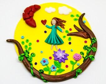 Magnet flower fairy picking a heart