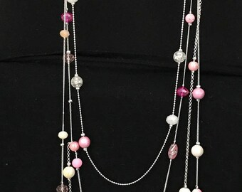 Long pink and white PomPoms with neon pink and white