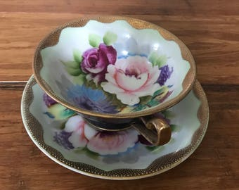 Fleur Delis rose print black and gold teacup and saucer