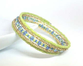 Memory wire bracelet. Lime green and gold seed beads. Blue swarovski crystals. Wrap bracelet