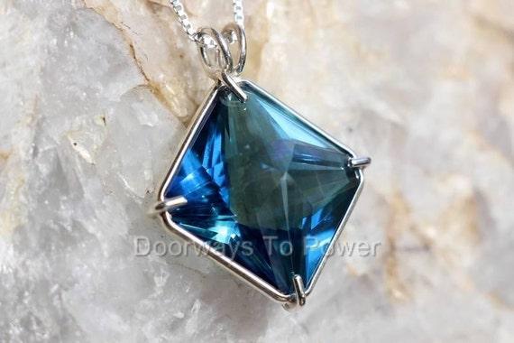 Aqua aura magician stone pendant aloadofball Image collections