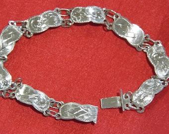 A Vintage Sterling silver etched panel bracelet