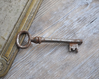 Antique rusty metal key.