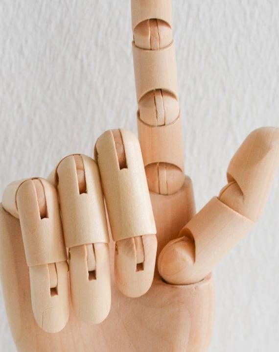 Wooden hand drawing manikin hand manikin hand model hand