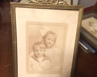 Two photos of Siblings in Original Frame