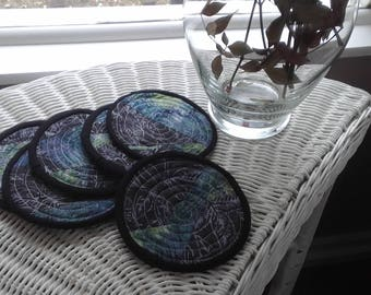Batik fabric coasters round in a set of 6. Greys,blues,and violet. 5 inch quilted.