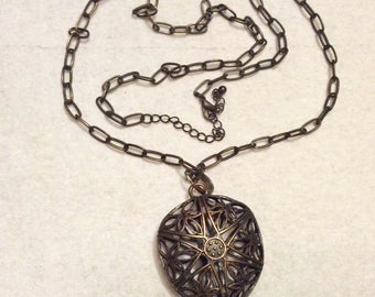 Blackened brass puff pendant filigree star necklace
