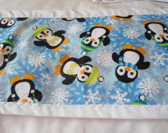 Burp Cloth with black and white Penquins on blue snow flake background
