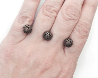 "Three Seeds ""Pierced Fingers"" Ring (Steel/Bronze/Gold Finishes)"
